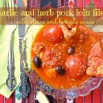 Garlic and herb pork loin filet with olives and tomato sauce