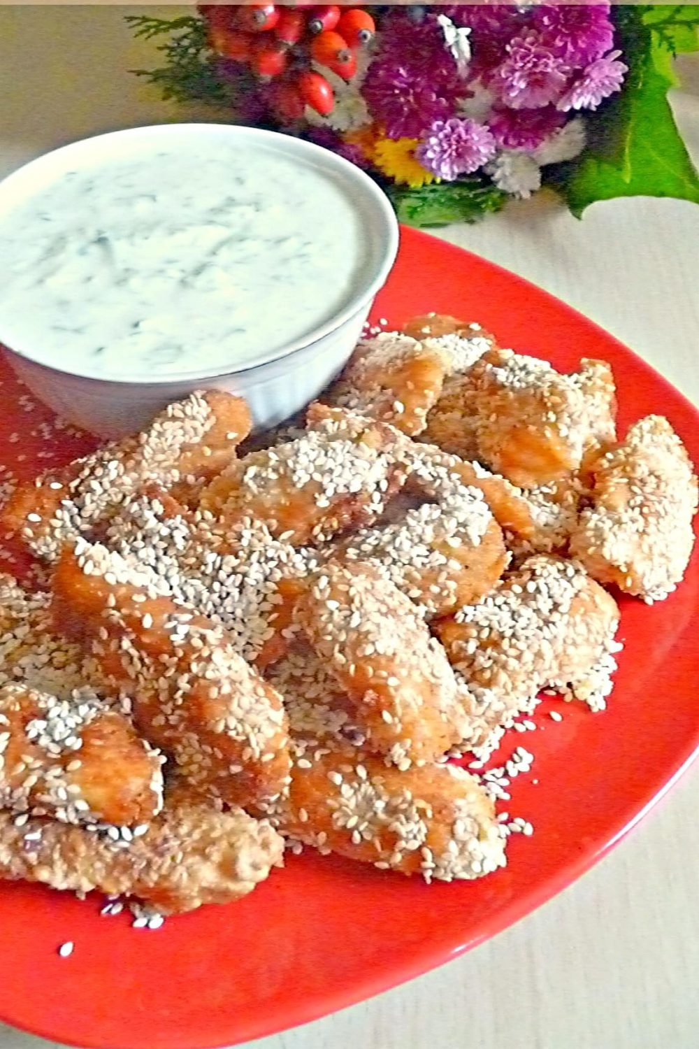 shanghai chicken with sesame seeds and tzatziki sauce