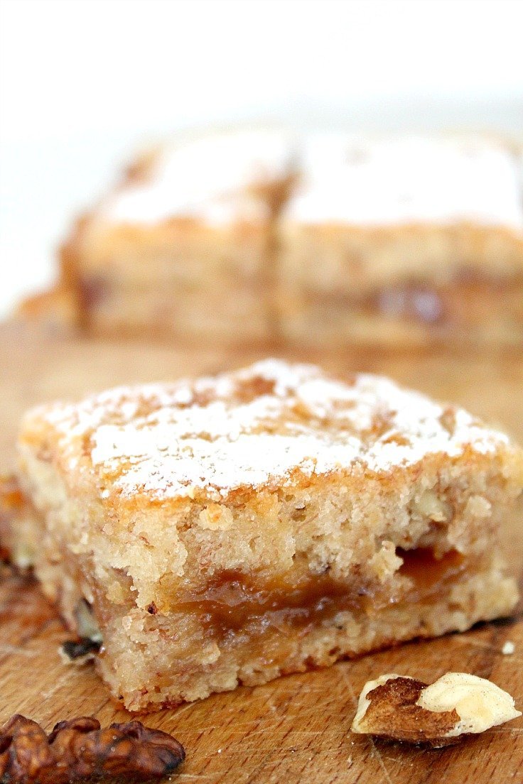 Banana blondies made with bananas walnuts and caramel sauce and cut into bars