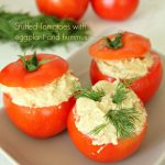 Stuffed fresh tomatoes with eggplant and hummus appetizer