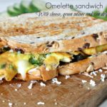 Omelette Sandwich with sun dried tomatoes, 3 cheeses and green onions