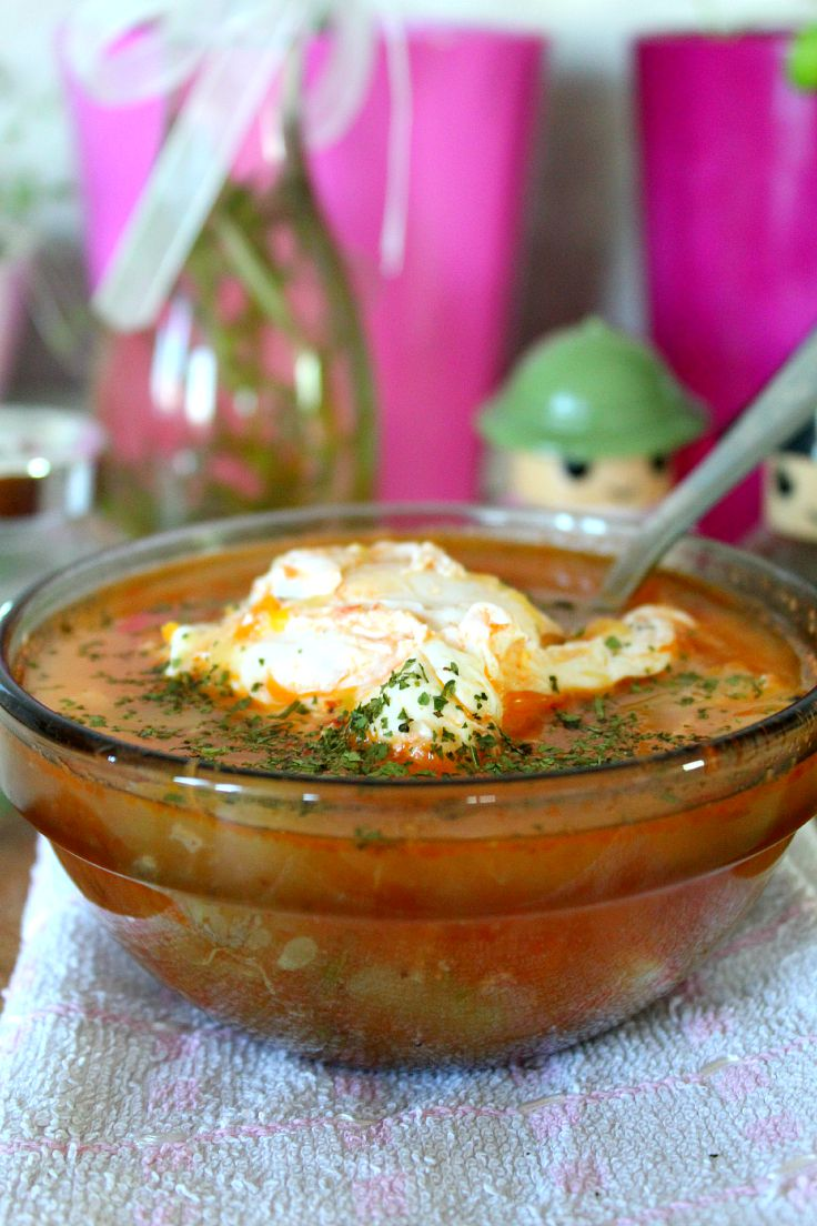 Chicken vegetable egg soup with whole eggs