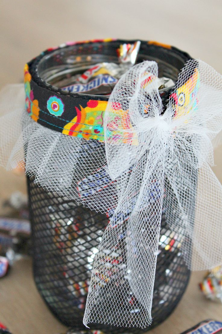 Halloween jar for candies made with fishnet stocking fabric and tulle