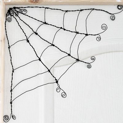 DIY Spooky Cute Halloween wire spider web