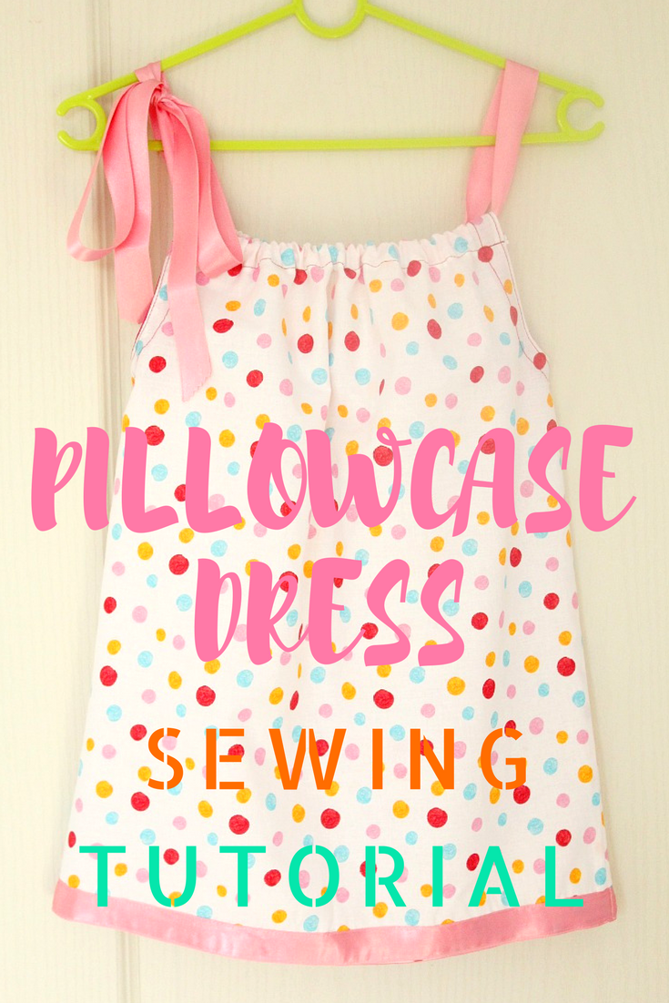 Pillowcase dress in polka dots with pink ribbon ties