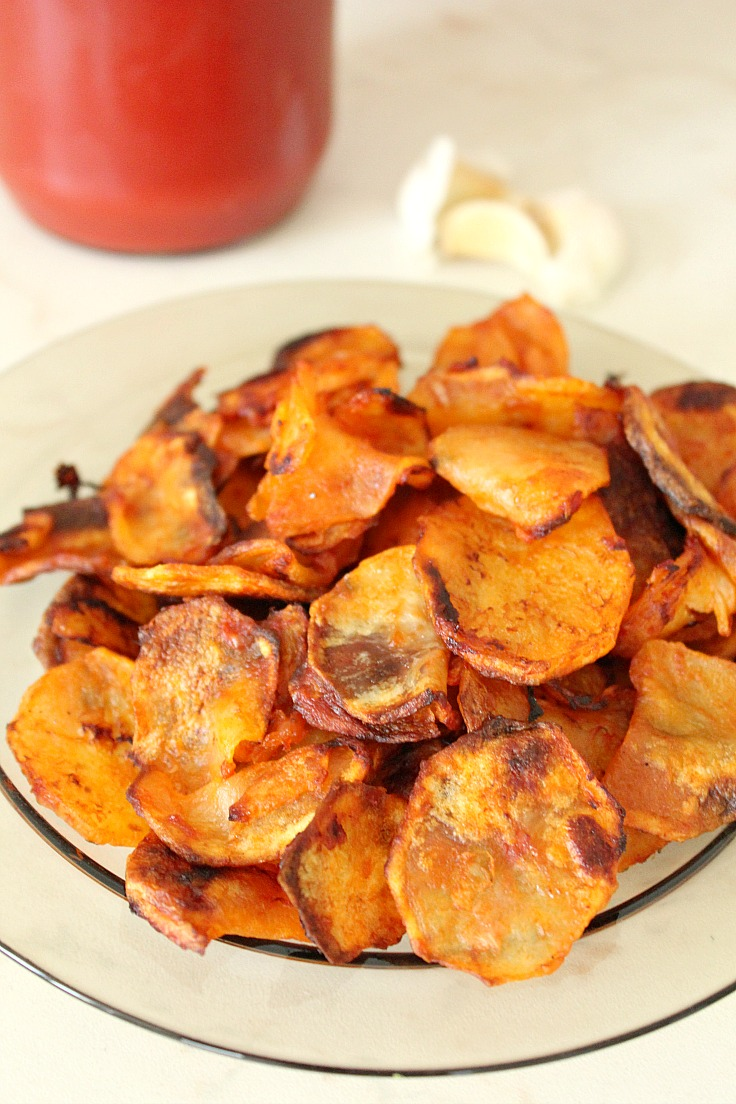 Homemade baked potato chips with vinegar garlic tomato sauce
