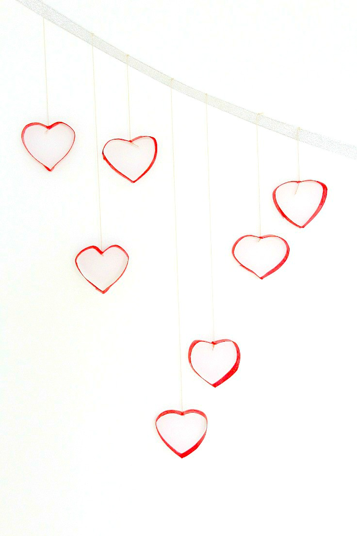 Wall decorating ideas are fun, exciting and can be a great and inexpensive way to add personality to a boring wall. Here's a Valentine's day wall decorations project, made with recycled toilet paper rolls.