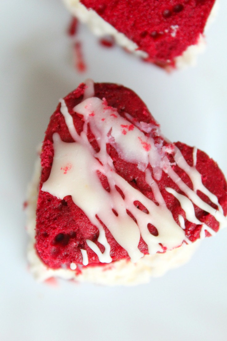 This mini sandwich cake recipe has two layers of red velvet cake and a delicious coconut cream cheese filling for the ultimate Valentine's Day dessert!