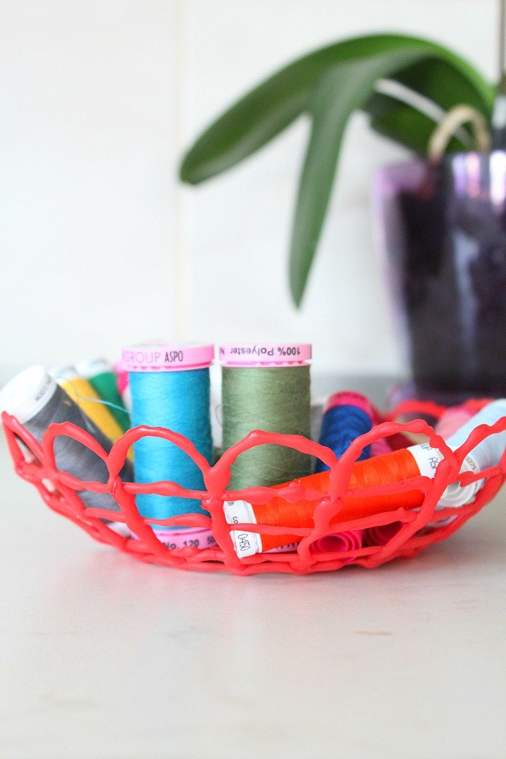 This hot glue bowl is a super cool, neat project to store sewing notions or craft supplies.