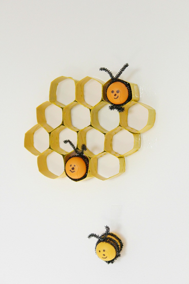 DIY Bees from Kinder eggs and chenille pipes, in a honeycomb made with toilet paper rolls