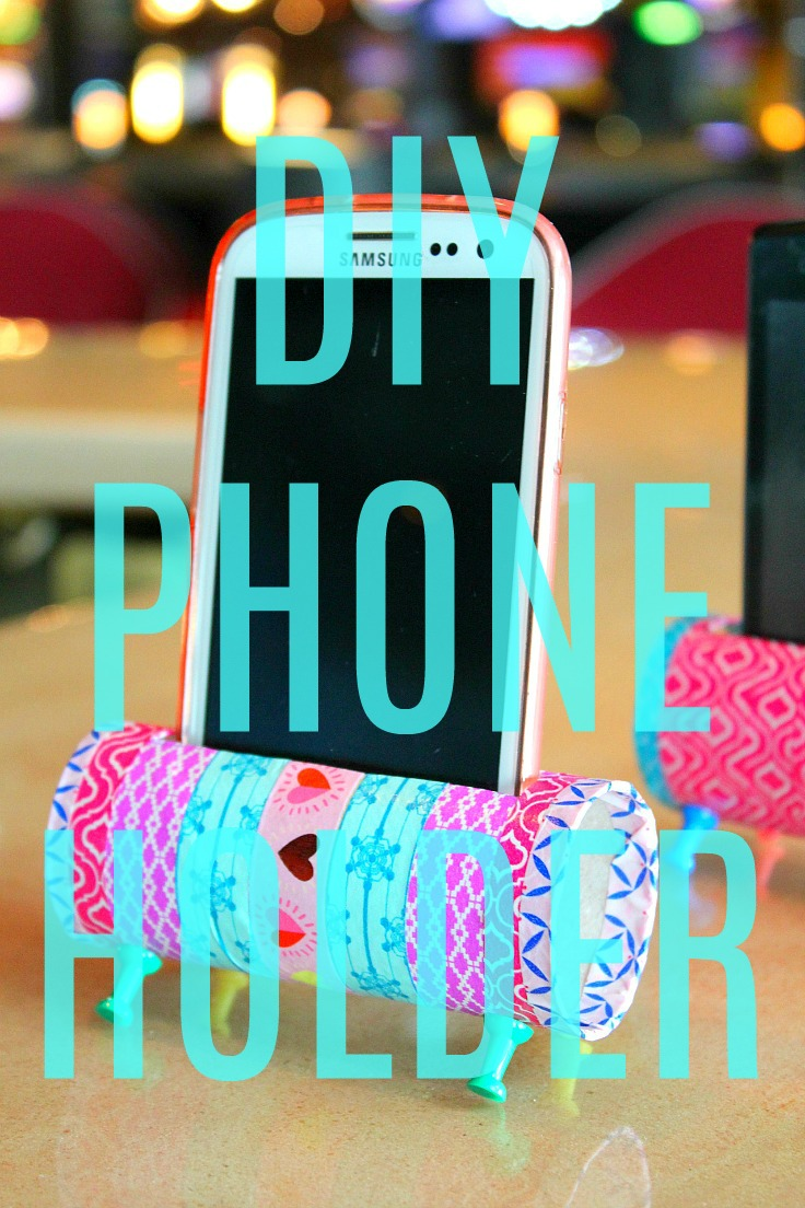 Easy DIY Phone Holder made from toilet paper rolls covered in colorful washi tape and supported with push pins