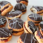 Chocolate covered sandwich cookies recipe filled with jam