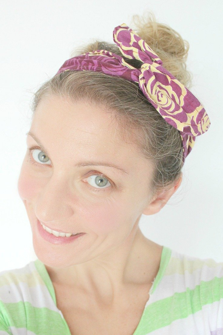 Image of a woman wearing a DIY wire headband in purple and light yellow.