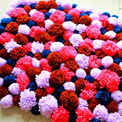 Make Your Own DIY Pom Pom Rug