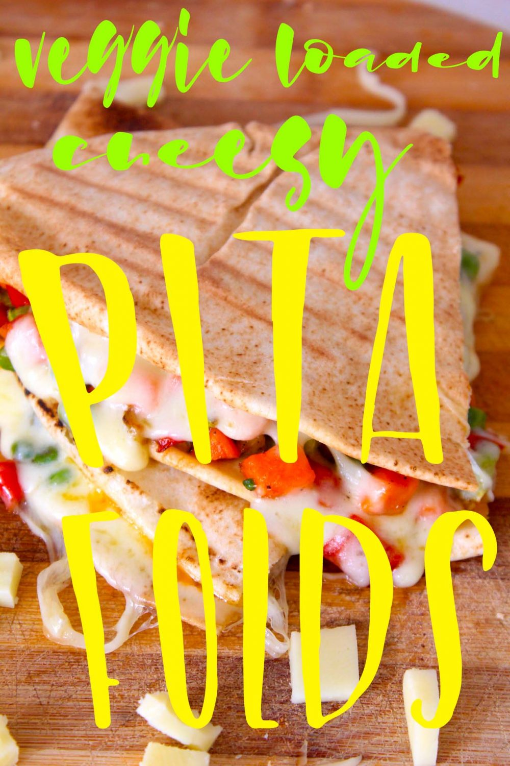 Try this insanely easy pita sandwich recipe for a quick, delicious dinner idea or a lunch on the go! Filled with healthy veggie and cheese, these are bursting with flavor!