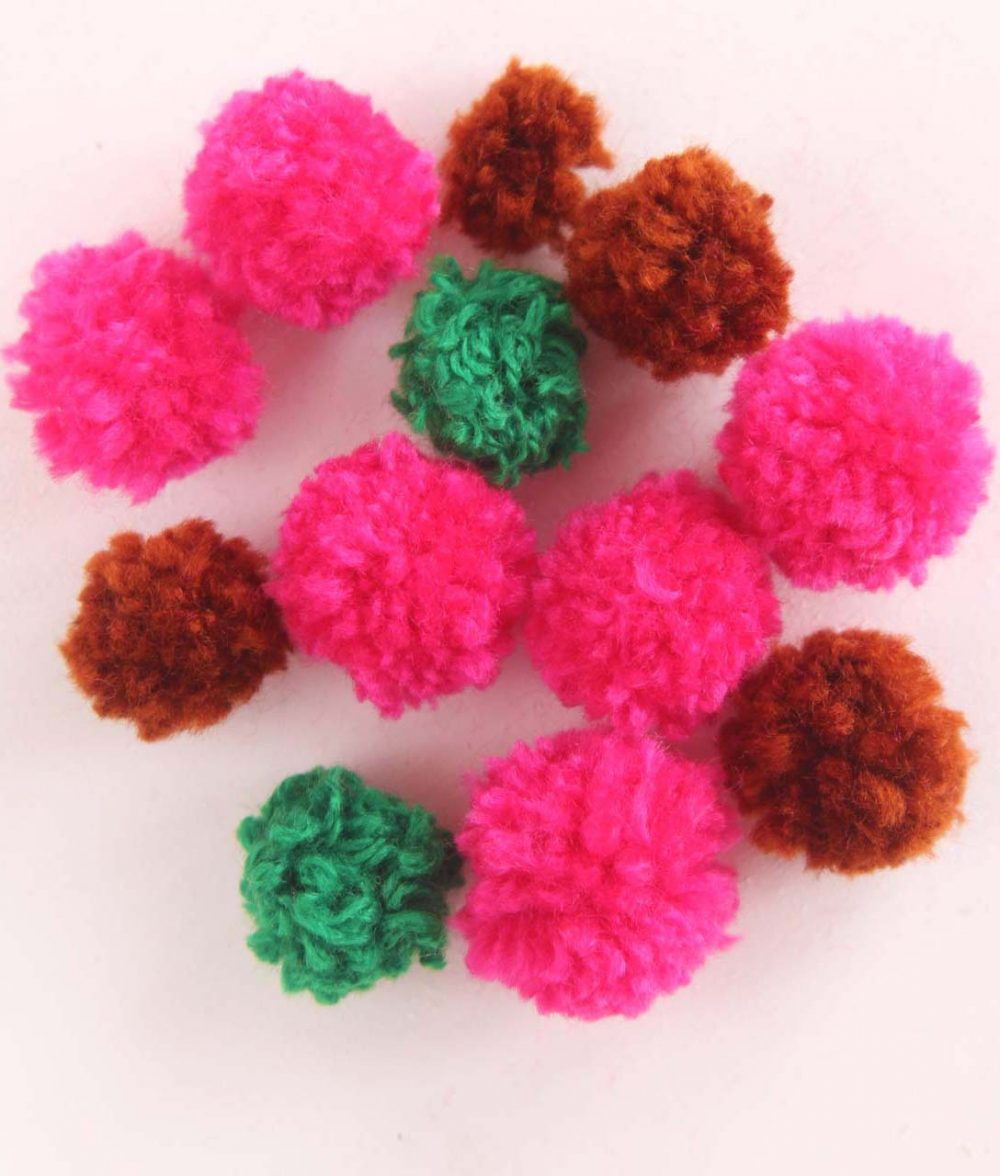 Image of Tiny Pom Poms in various colors
