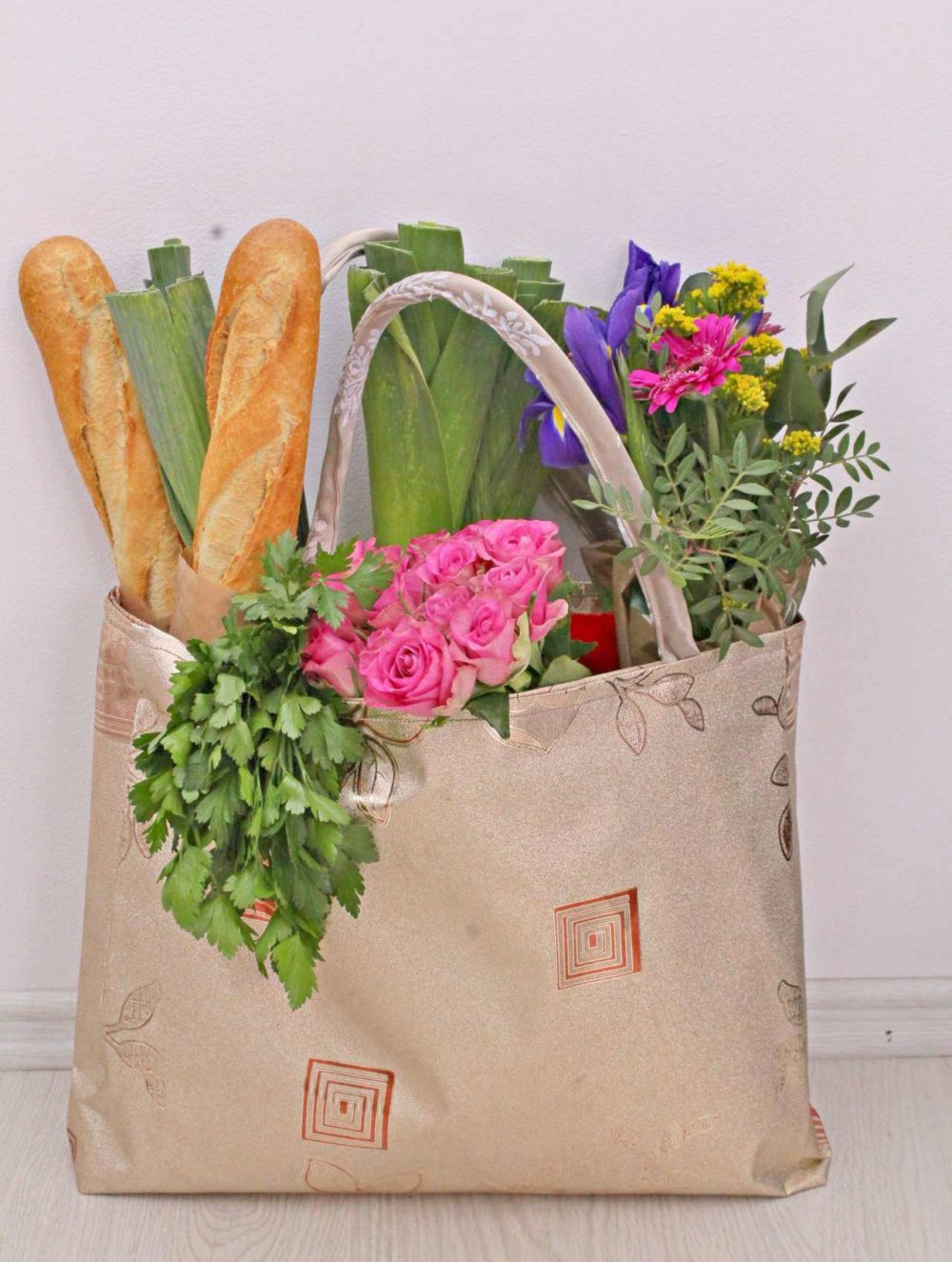 Grocery bag pattern for a reusable tote bag that is made out of vinyl, is reversible, sturdy, roomy and durable.