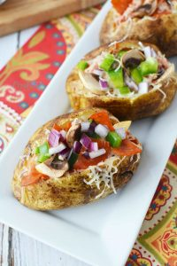 Perfect for any gatherings, parties or barbecues, these pizza baked potatoes are loaded with pepperoni, mushrooms, peppers and cheesy goodness!