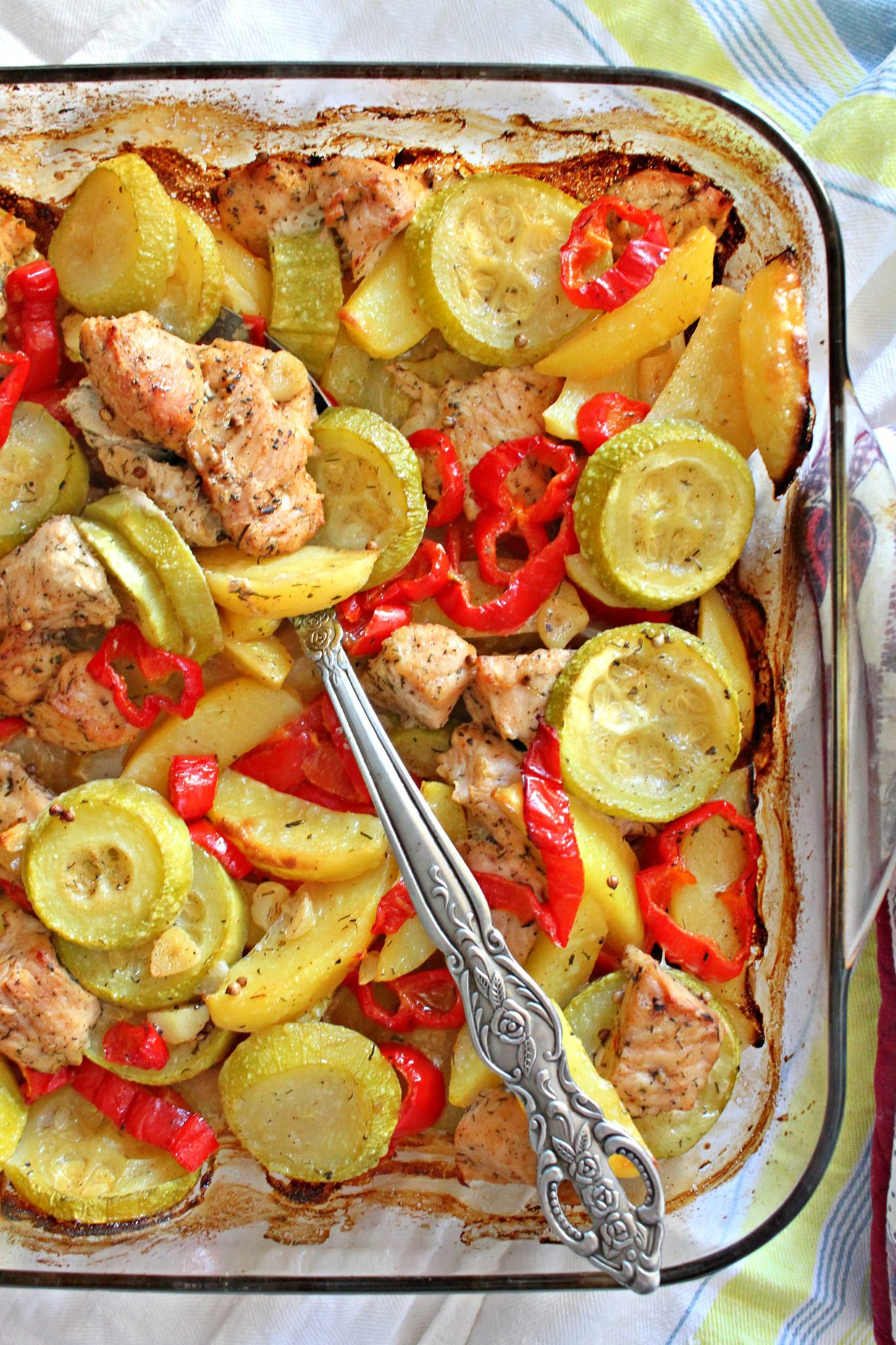 Baking dish with sweet and picy turkey breast and vegetables, made with brown sugar, paprika lemon juice and herbs