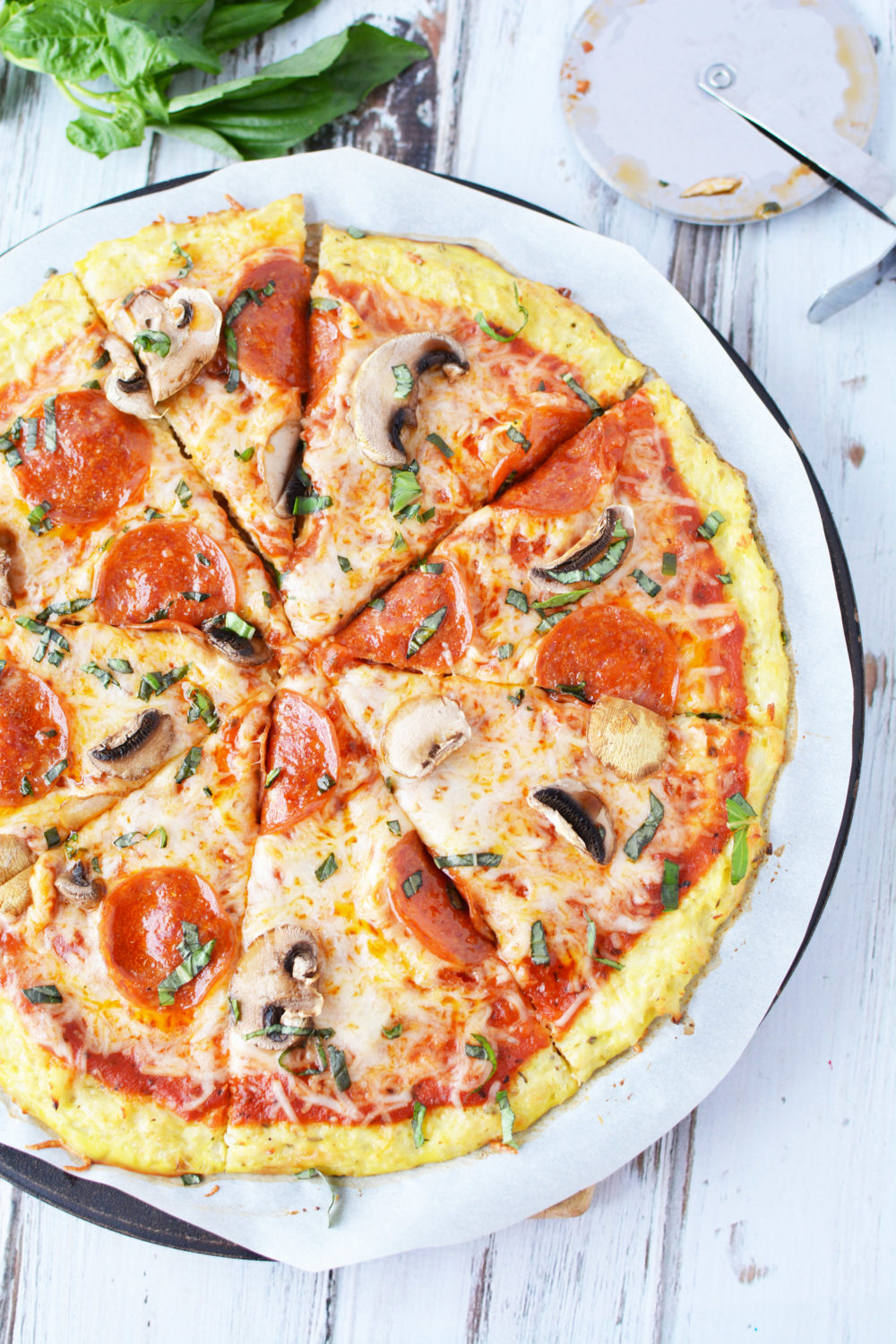 make your favorite pizza using this amazing crispy cauliflower pizza crust!