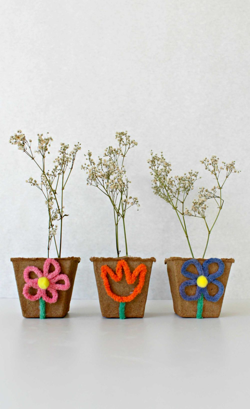 Mini flower pots made from peat pots and chenille pipe cleaner