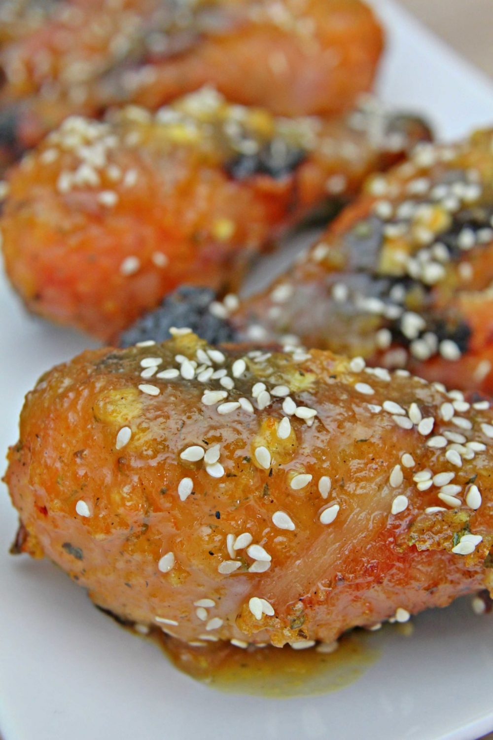Orange chicken drumsticks baked in the oven and sprinkled with sesame seeds