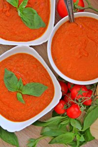 easy tomato basil soup in white bowls