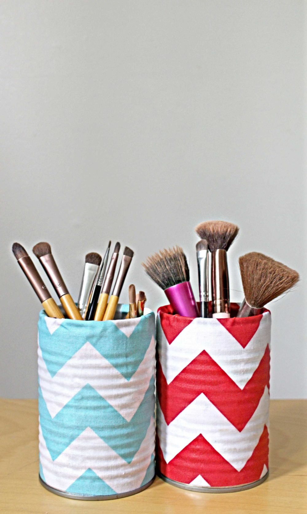 makeup storage organizer with tin cans and fabric