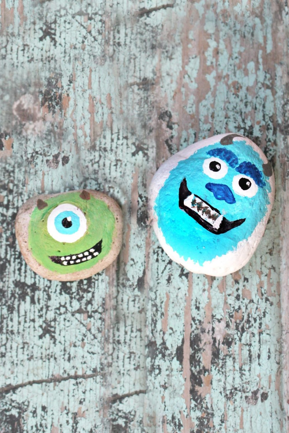 Monster painted rocks on a wood table