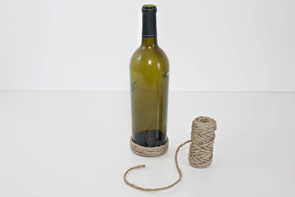 Wine bottle art gorgeous recycling idea for home decor twine wrapped bottles solutioingenieria Image collections