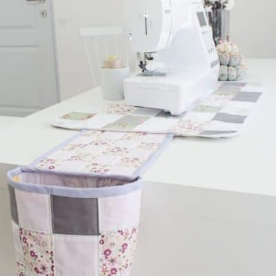 Quilted sewing mat with thread catcher
