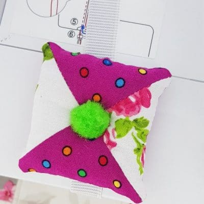 Half-square triangle patchwork pincushion