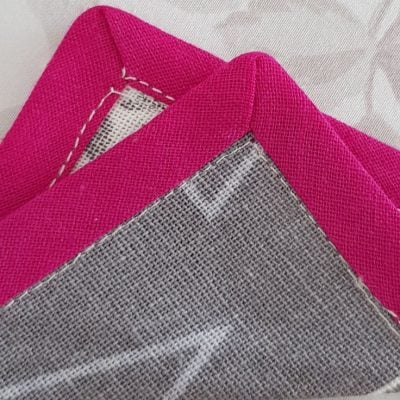 Sewing mitered corners with bias tape