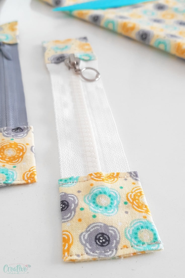 Sewing zipper tabs