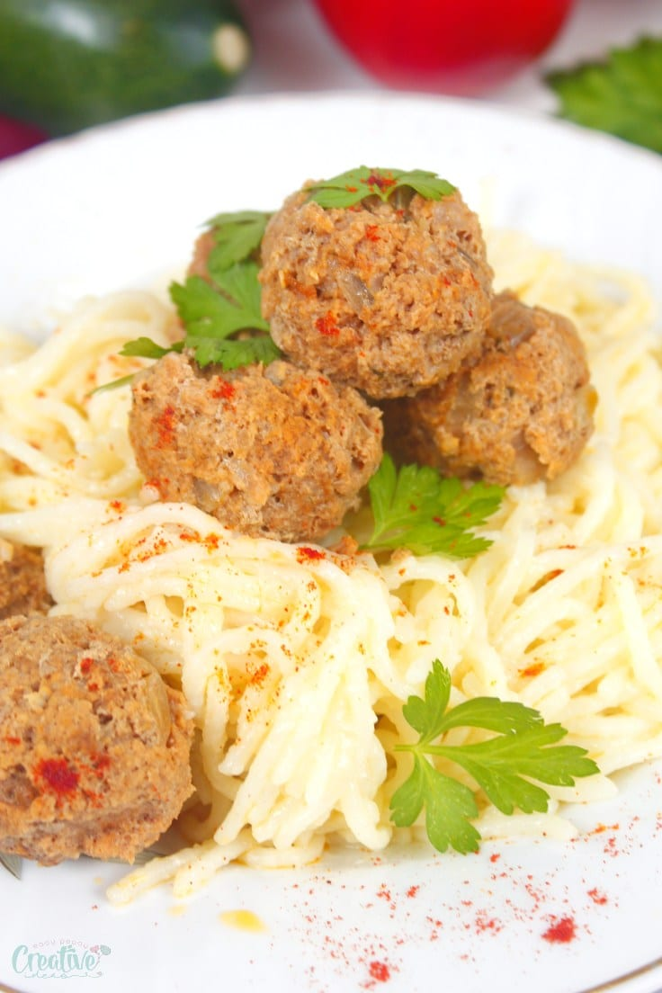 Meatballs made in the slow cooker on top of spaghetti