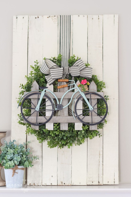 Image of front door wreath with bicycle detail