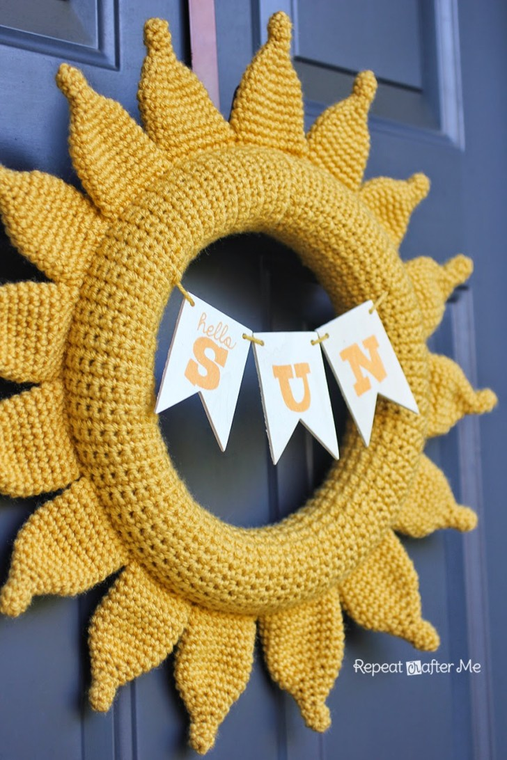 Image of a crochet front door wreath in the shape of the sun