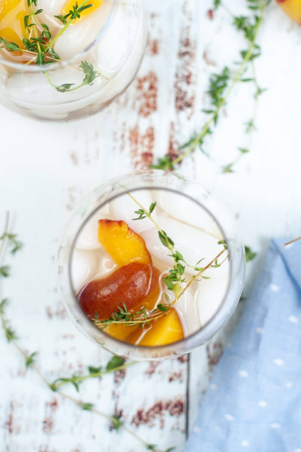 Image of peach cocktail recipe in a glass, shot from the top