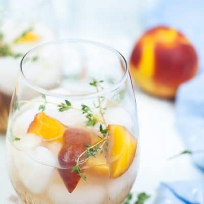 Absolutely delicious PEACH COCKTAIL with peach syrup and thyme