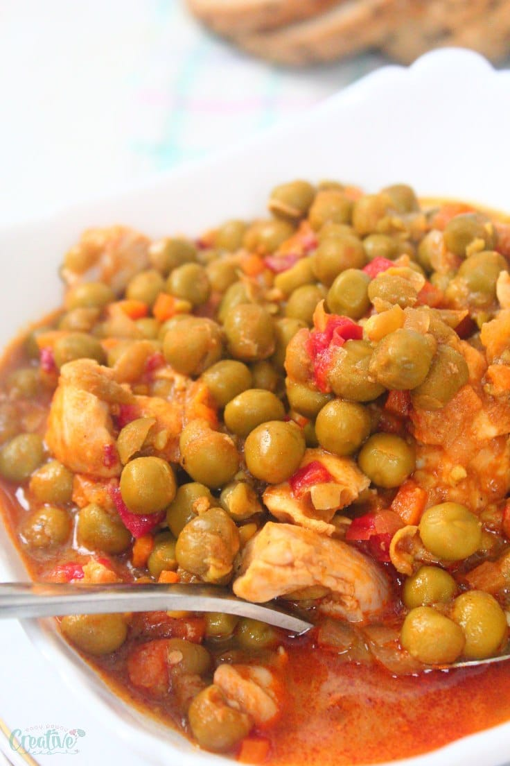 Image of healthy slow cooker chicken stew with peas served in a white bowl