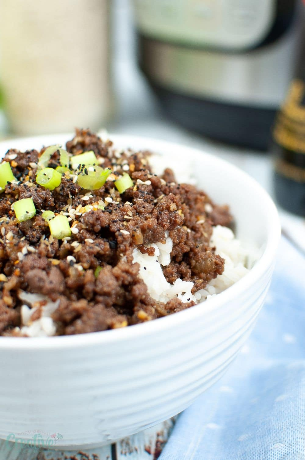 Image of a white bowl filled with Korean beef on rice