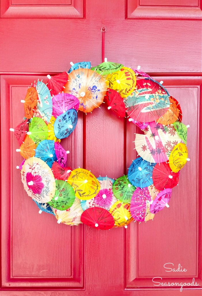 Image of front door wreath made with small umbrellas for drinks