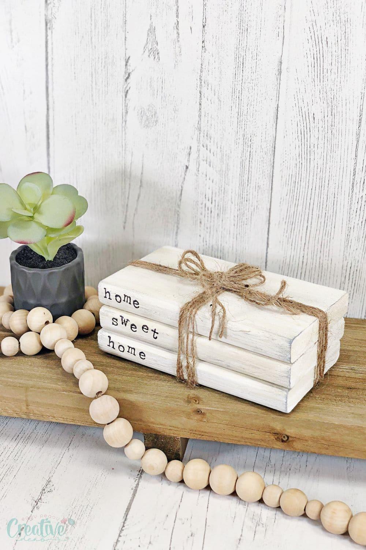 Image of farmhouse style DIY book stacks on a shelf