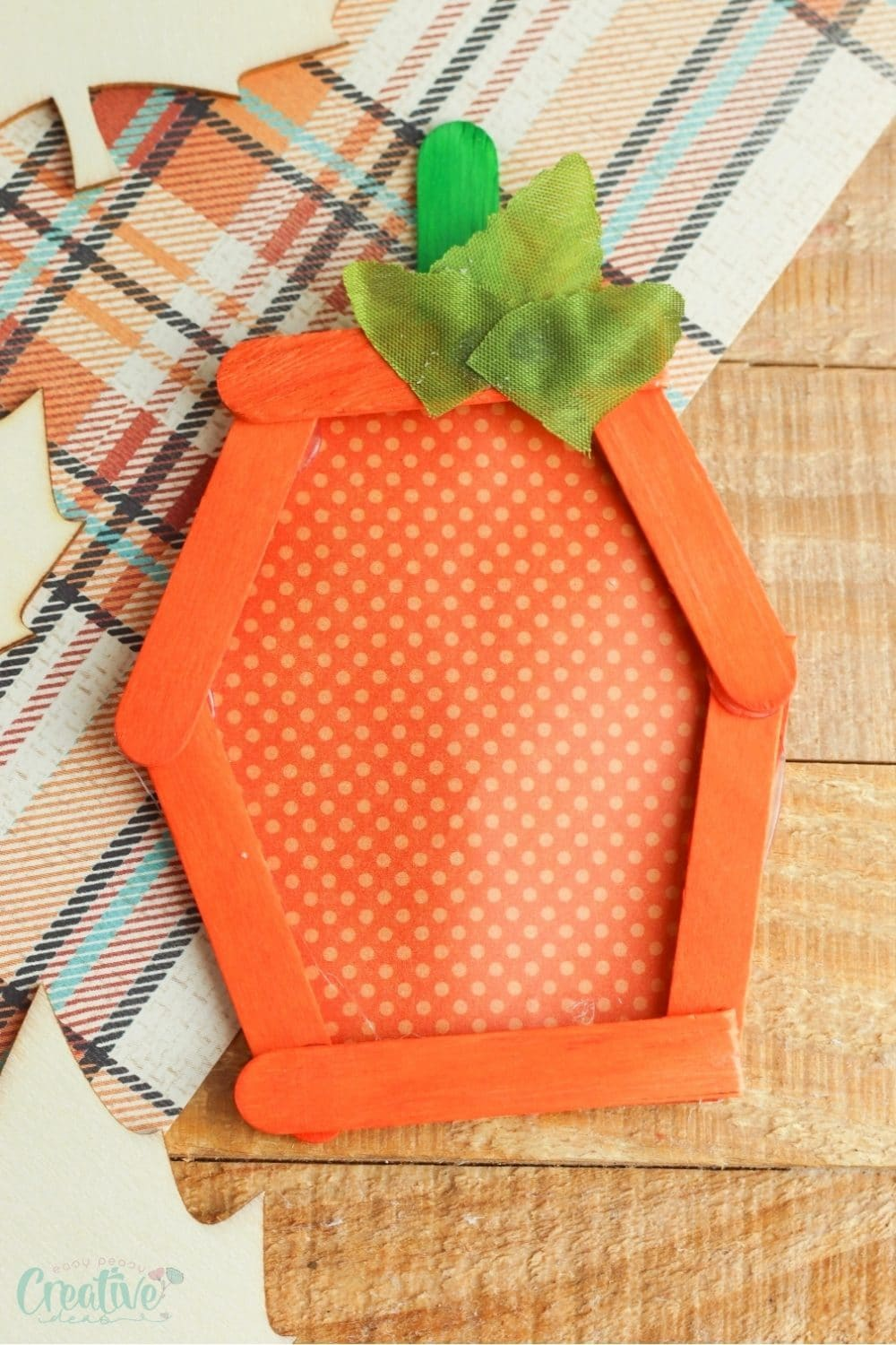 Image of an easy pumpkin craft created with popsicle sticks and paper