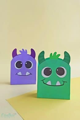 Image of paper Halloween treat bags in green and navy blue