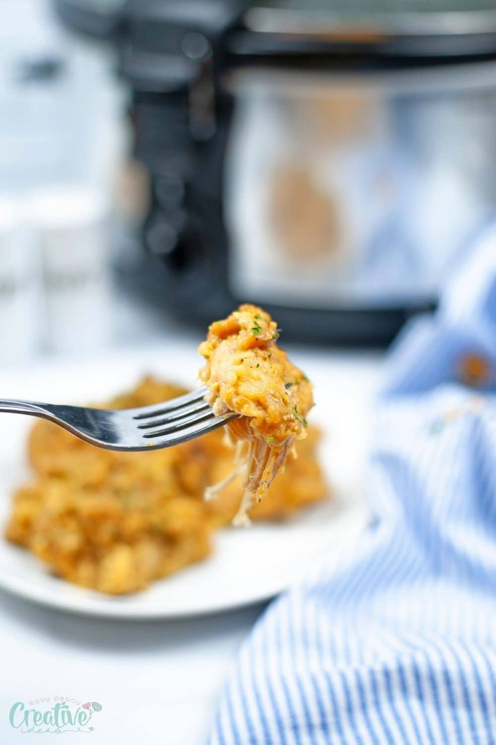 A piece of slow cooker chicken stuffing on a fork