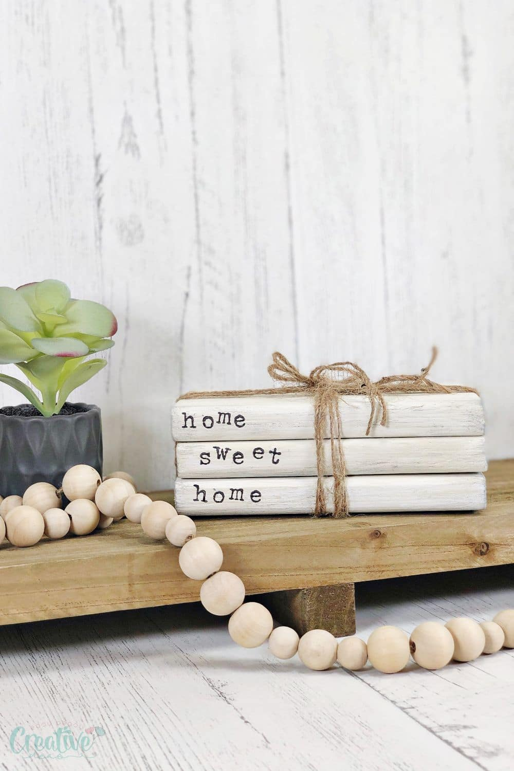 Image of white wood book stacks with letter stamps