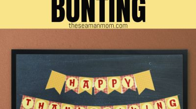 Image of printable Thanksgiving banner styled on a chalk board displayed next to a few pumpkins